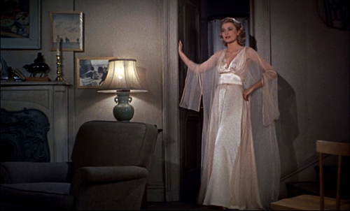Grace Kelly in Rear Window, getting ready for a sleep over with James Stewart.